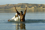 A Man Baptized in the River Jordan