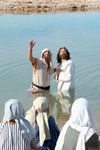 Baptizing in a River