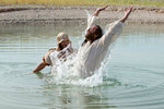 Man Rejoices Out of Water After Being Baptized