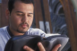 Hispanic Man Reading Bible
